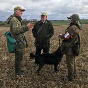 Trainers Garry Ellison and Malcolm Peacock discuss some training tips with on of the handlers.